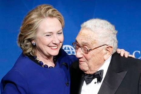 Clinton puts her arm around Kissinger after he presented her with a Distinguished Leadership Award from the Atlantic Council in Washington