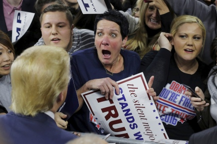 Audience member Robin Roy reacts as U.S. Republican presidential candidate Donald Trump greets her at a campaign rally in Lowell