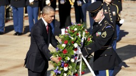 U.S. President Barack Obama lays a wreath at the Tomb of the Unknown Soldier on Veterans Day, at Arlington National Cemetery in Virginia