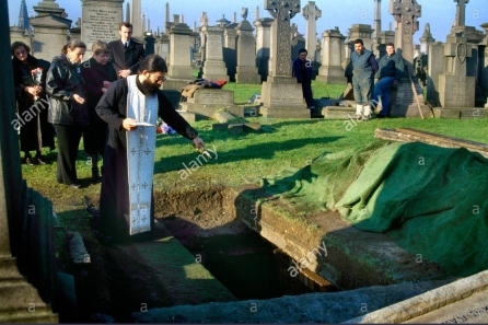greek-orthodox-funeral-pouring-olive-oil-into-grave-ax1m23-e1572997703865.jpg?w=446&profile=RESIZE_710x