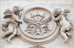 angels-symbols-martyrdom-angels-symbols-martyrdom-portal-sant-andrea-della-valle-church-rome-italy-99433042